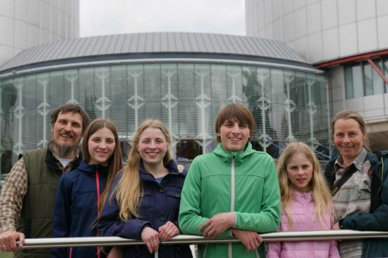 Dirk and Petra Wunderlich are pictured with their four children.