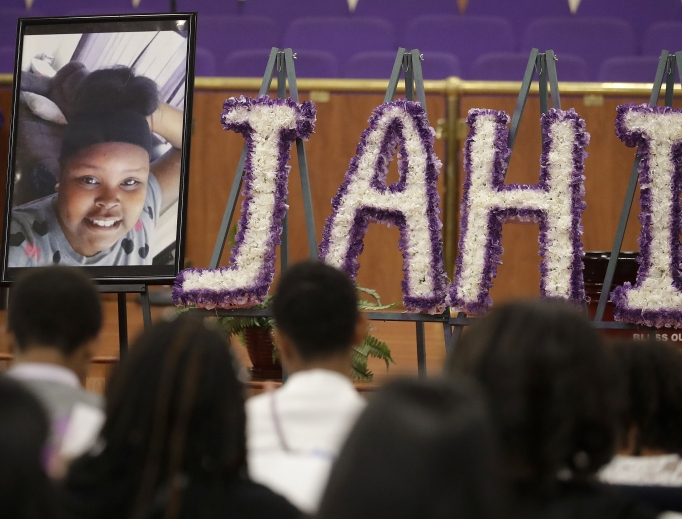 A photo of Jahi McMath is shown at funeral services for McMath at Acts Full Gospel Church in Oakland, California, July 6. Dozens of family members, friends and other mourners filled the Northern California church for the funeral of the teenage girl at the center of a medical and religious debate over brain death.