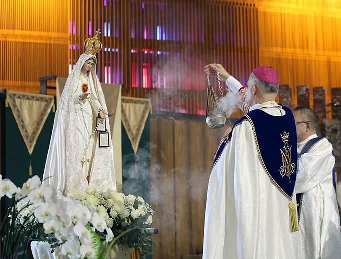 Archbishop Salvatore Cordileone censes a statue of Our Lady of Fatima at St. Mary's Cathedral on Oct. 7.