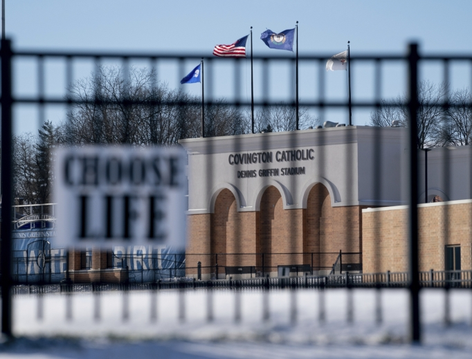Flags fly over the Covington Catholic High School stadium in Park Kills, Kentucky, as a pro-life sign hangs on a fence, Jan. 20.