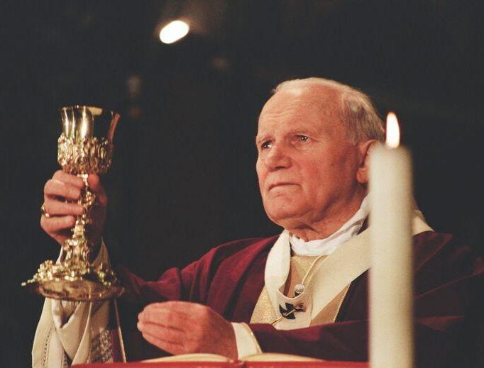 REVERENCE SPEAKS. Pope John Paul II celebrates Mass in 1994.