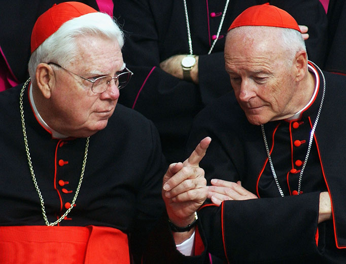 In this 2003 file photo, Cardinal Bernard Law and then-Cardinal Theodore McCarrick meet in St. Peter's Square.