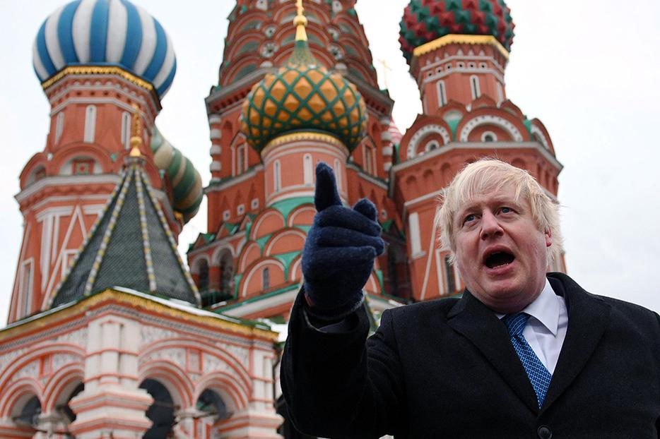 Boris Johnson stands in front of Saint Basil's cathedral in Moscow, Dec. 22, 2017.