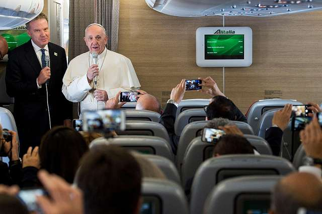 Pope Francis speaks to journalists aboard the flight from Rome to Bogota Sept. 6.