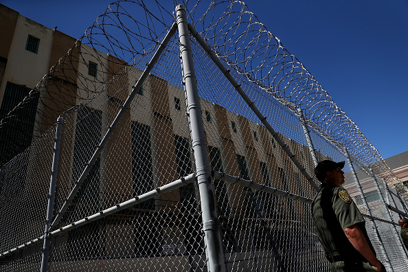 An armed California Department of Corrections and Rehabilitation officer stands guard at San Quentin State Prison's death row Aug. 15, 2016, in San Quentin, California. San Quentin State Prison opened in 1852 and is California's oldest penitentiary. The facility houses the state's only death row for men.