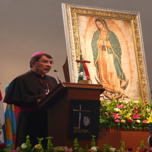 """Archbishop Christophe Pierre, apostolic nuncio to Mexico, speaks at the Shrine of Our Lady of Guadalupe during a conference entitled """"Our Lady of Guadalupe, Star of the New Evangelization on the American Continent,"""" on Nov. 16, 2013."""