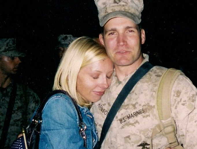 J.J. Hanson hugs his wife, Kristen, upon his return from a combat tour in Iraq