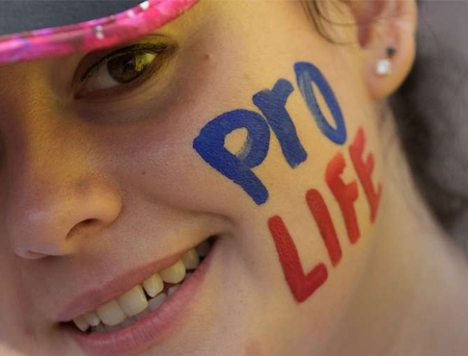 Young woman takes part in a pro-life rally in Ireland.