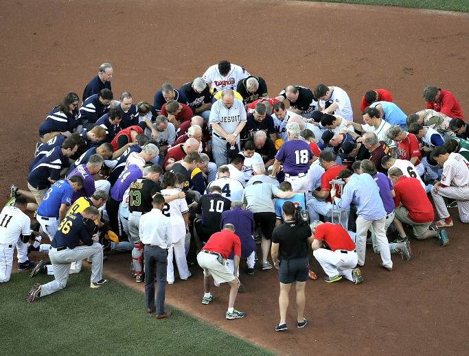 Members of the Republican and Democratic congressional baseball teams gather for prayer before the start of the Congressional Baseball Game at Nationals Park on June 15 in Washington. U.S. House Majority Whip Rep. Steve Scalise, R-Louisiana, remained in critical condition following a shooting June 14 during a Republican congressional baseball team practice.