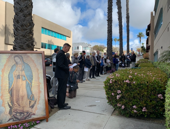 Above, Bishop Joseph Coffey prays the Rosary in front of a Planned Parenthood center in San Diego.