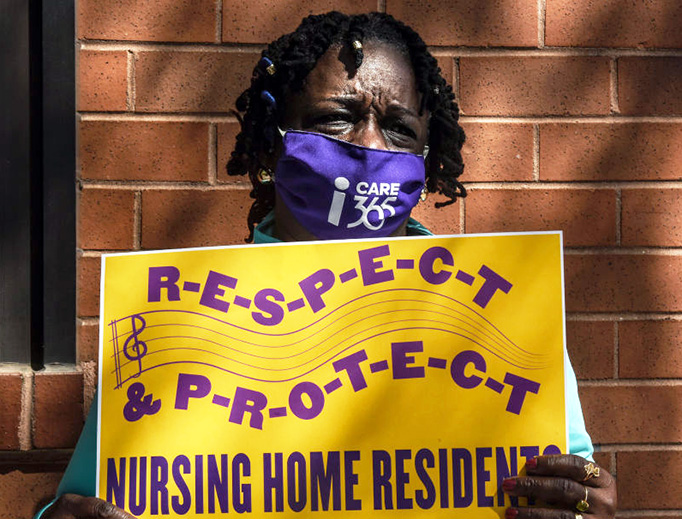 A nursing home worker participates in a vigil outside of the Downtown Brooklyn Nursing and Rehabilitation Center on May 21, 2020, in New York City.