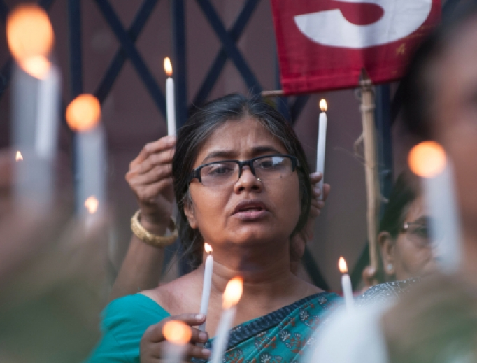 People hold candles during a rally to protest the sexual assault of a 70 year old nun in Kolkata, India on March 18, 2015.