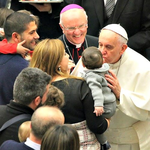 Pope Francis meets with families during a papal audience in February