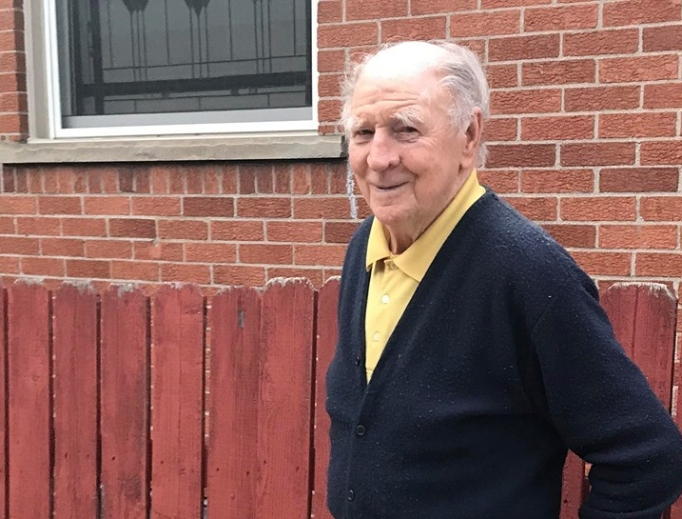 Above, John Rainy is doing well, relying on his faith and good pursuits: 'God keeps me busy, although it does not take much to keep you busy when you are 88. Give me a good book, and I'm satisfied very easily.'