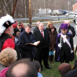 Father Brian Gannon (l) blesses the 2010 Trumbull Nativity display flanked by a Knights of Columbus honor guard.