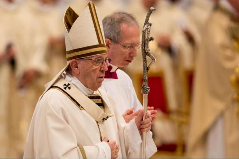 Pope Francis celebrates the chrism Mass at St. Peter's Basilica March 29.