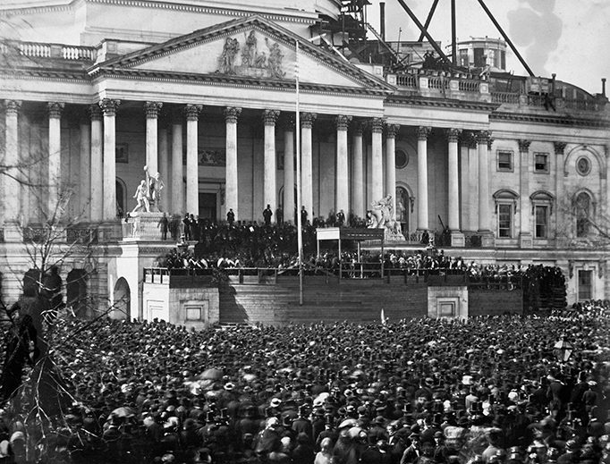 A crowd gathers at the first inauguration of President Abraham Lincoln on Marcy 4, 1861 — the first presidential inauguration ever photographed — at the U.S. Capitol, Washington, D.C.