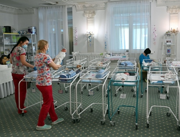Nurses care for newborn babies at the Kyiv's Venice hotel on May 15. More than 100 babies born to surrogate mothers have been stranded in Ukraine, as their foreign parents cannot collect them due to border closures imposed during the coronavirus pandemic.