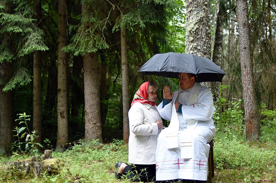 Above, a Catholic priest hears a confession during the annual Mother of Perpetual Help in the forest near the village of Dubok, Belarus, on July 1, 2018.