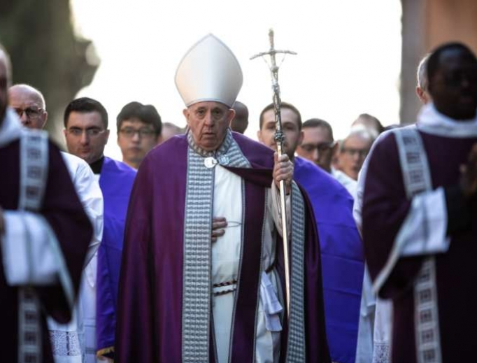 Pope Francis leads a penitential procession towards the Basilica of Santa Sabina in Aventino for Ash Wednesday.