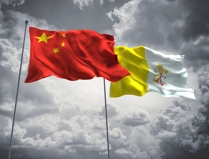 The Chinese flag waves next the Vatican flag.