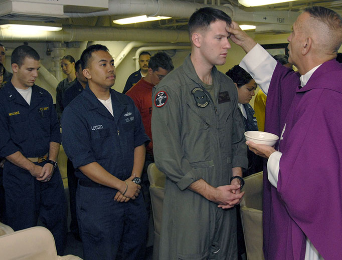 Sailors and Marines prepare to receive ashes during Ash Wednesday Mass aboard the amphibious assault ship USS Boxer (LHD 4) in 2009. (U.S. Navy photo by Mass Communication Specialist 2nd Class John J. Siller/Released)