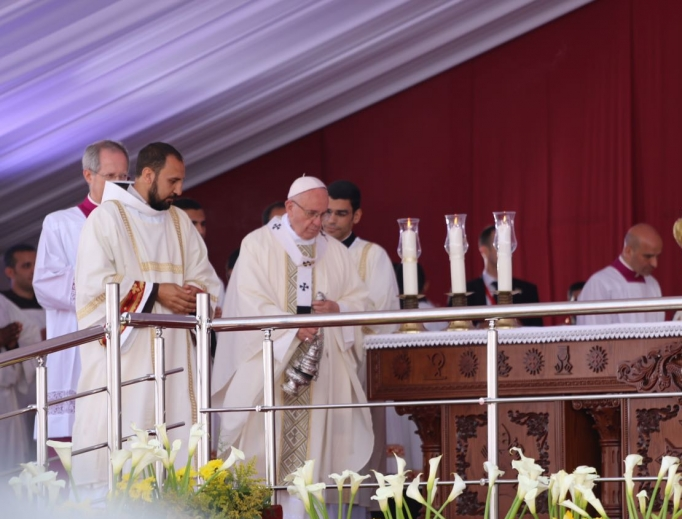 Pope Francis celebrates Mass at the Air Defense Stadium in Cairo, Egypt, on April 29.