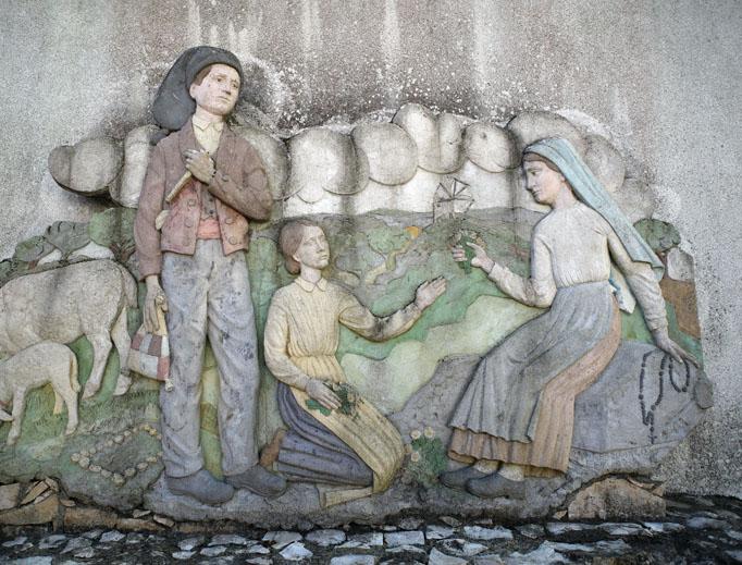 A mural adorns Lucia dos Santos' home near Fatima.