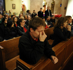 Mourners gather inside the St. Rose of Lima Roman Catholic Church at a vigil service for victims of the Sandy Hook School shooting Dec. 14 in Newtown, Conn.
