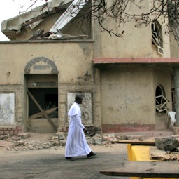 Msgr. Obiora Ike walks in front of St. Leo the Great Catholic Church in Enugu, Nigeria.