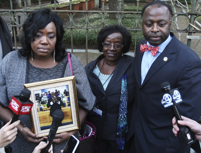 Family of the late Daniel Simmons Sr. — Rose Simmons, left, daughter; former wife Annie Simmons; and son Daniel L. Simmons Jr. — speak to the media after the death-sentence hearing for Dylann Roof on Jan. 11, in Charleston, South Carolina.