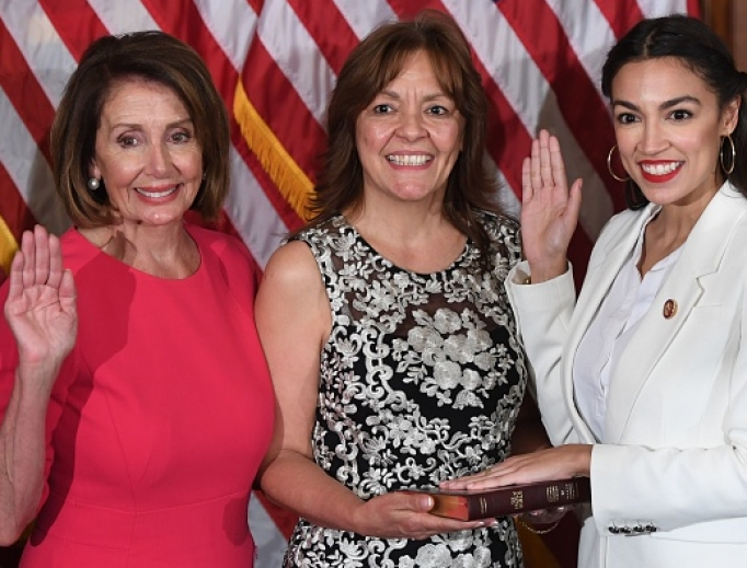 Speaker of the House Nancy Pelosi (l) performs a ceremonial swearing-in for U.S. Rep. Alexandria Ocasio-Cortez (r), D-N.Y., at the start of the 116th Congress at the U.S. Capitol in Washington Jan. 3.