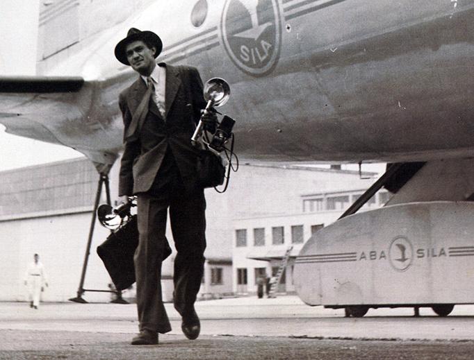 Photographer Lennart Nilsson carries his camera at Stockholm Arlanda airport in 1946.