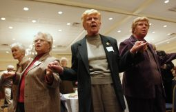 'OPPRESSED CLASS?' Women recite the Lord's Prayer during Mass at the Voice of the Faithful national conference in Melville, N.Y., in 2009.