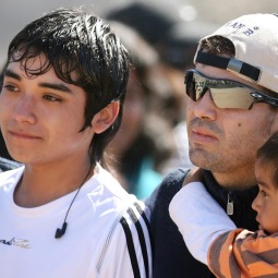 GRATEFUL. Rescued Chilean miner Alex Vega, center, arrives with family members to the San Jose mine in Copiapo, Chile, Oct. 17. Some of the 33 miners rescued last week after 69 days trapped underground returned to the copper and gold mine for a Mass of thanksgiving.