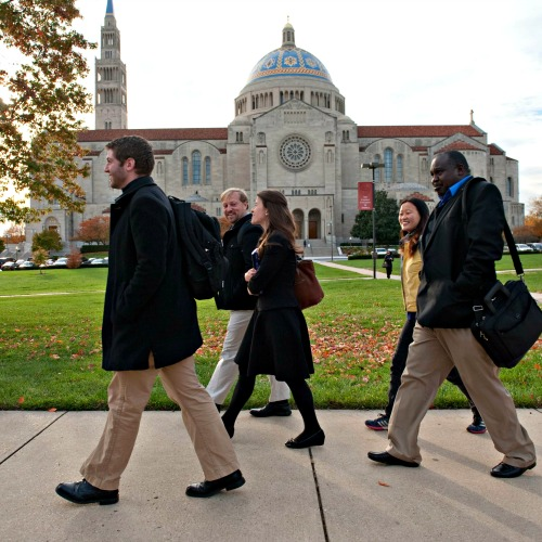 Students from the Pontifical John Paul II Institute for Studies on Marriage and Family, on the campus of The Catholic University of America, walk past the Basilica of the National Shrine of the Immaculate Conception in Washington.