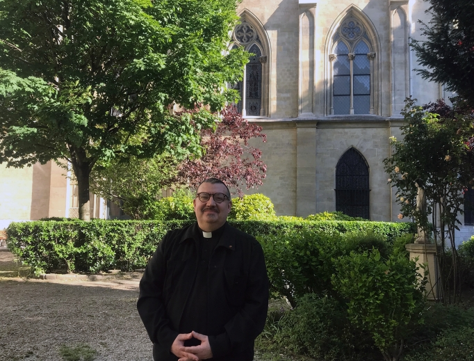 Father Jean-Marc Fournier, shown at the Diocese of the French Armed Forces in Paris, received worldwide recognition for saving sacred items, including the Blessed Sacrament, amid the Notre Dame Cathedral fire last month.