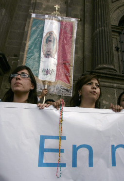 People supporting Cardinal Juan Sandoval Iniguez of Guadalajara, Mexico, pray outside the cathedral in Guadalajara Aug. 22. The Mexican Supreme Court recently upheld the legality of same-sex couples adopting children and rebuked Cardinal Sandoval, who accused the 11 judges of being bribed by the mayor of Mexico City and international organizations.