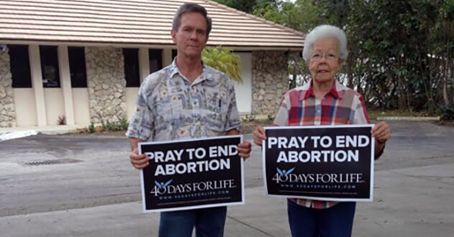 Two pro-life supporters at the 40 Days for Life campaign on Feb. 10 in Hollywood, Florida
