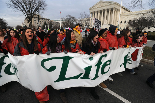 BEING HEARD. March for Life participants make their way up past the Supreme Court building in Washington Jan. 22. The annual anti-abortion demonstration marks the 1973 Supreme Court decision that legalized abortion across the nation. Congressman Bart Stupak believes pro-lifers who come to the annual March for Life have an impact in the halls of Congress.
