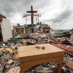 A wooden altar, a cross, some metal beams and pieces of a few cinder-block walls of St. Mary's Catholic Church in Joplin, Mo., are all that are left standing May 25. The church, rectory, school and parish hall were destroyed by a massive F-5 tornado May 22. As of early May 26, the number of those killed by the tornado totaled 125.