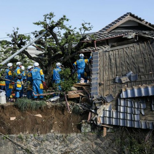 A rescue team tries to save victims after a 6.4 magnitude earthquake hit Kumamoto, Japan, April 16, 2016.
