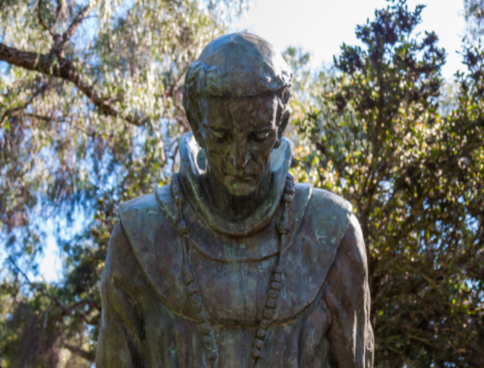 A statue with the bowed head of Saint Junipero Serra at the Serra Mission Museum, the former site of a fort and the first Pacific Coast European settlement.