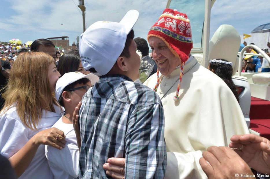 Pope Francis experiments with local fashion trends Jan. 20 in Trujillo, sporting a typical Peruvian chullo hat made of wool.