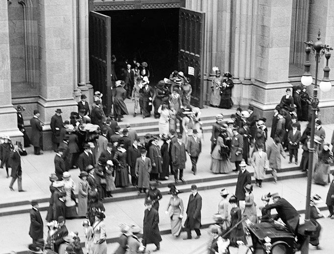 Above, Worshippers exit St. Patrick's Cathedral in New York on Easter 1910. Below, a 1914-15 baptismal registry is among those being newly archived.