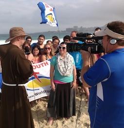 On Copacabana beach in Rio, Father John Paul Zeller interviews pilgrims for 'Life on the Rock.'
