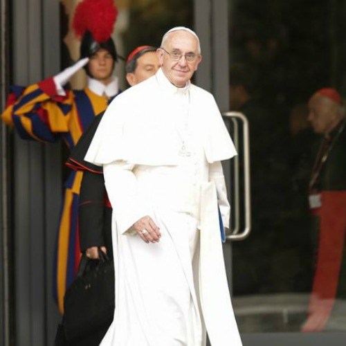 Pope Francis walks out of the Paul VI Hall during the synod on the family on Oct. 9.