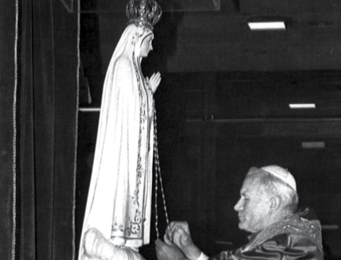 Pope John Paul II prays in front of the statue of the Virgin Mary at the Chapel of the Apparitions in Fatima, May 12, 1982, to give thanks for surviving an assassination attempt in 1981.