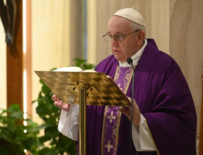 Pope Francis reads the Gospel during Mass at Casa Santa Marta on April 2, 2020.