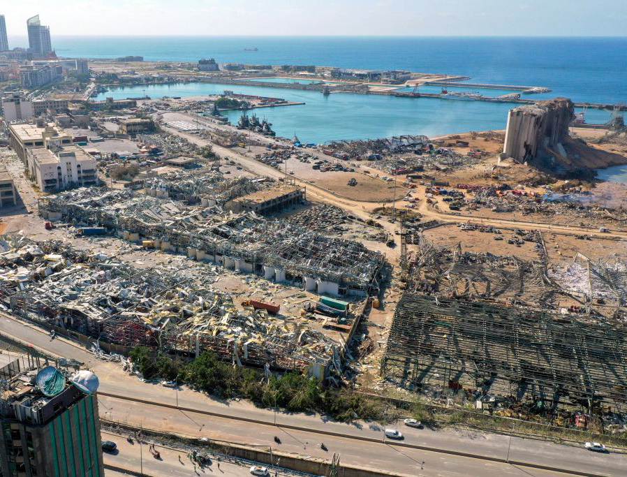 An aerial view shows the massive damage done to Beirut port's grain silos and the area around it today, one day after a mega-blast tore through the harbor in the heart of the Lebanese capital with the force of an earthquake, killing more than 100 people and injuring more than 4,000.